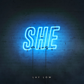 SHE – LAY LOW